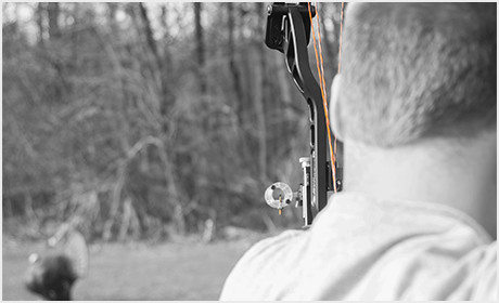 Man Shooting An Arrow with His New Custom Bowstrings