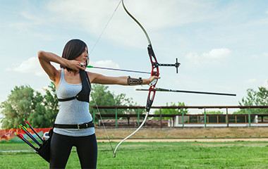 Girl Using Archery Supplies and Aiming Crossbow Outside - 2-20