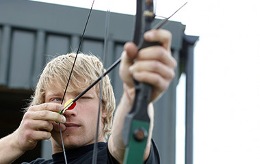 Guy With Blonde Hair Outside Using Archery Supplies - 1-25